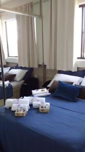 A bed or beds in a room at Apartamento Fortaleza.