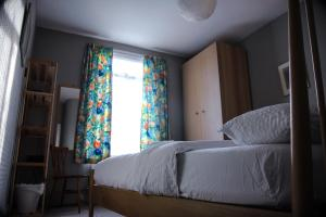 A bed or beds in a room at King Size Bed B&B + Self Catering
