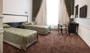 A bed or beds in a room at Black Sea Hotel Park Shevchenko