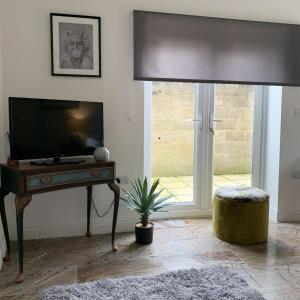 A television and/or entertainment center at Allure Watford Apartment