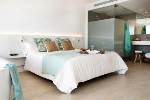 A bed or beds in a room at Els Pins Resort & Spa