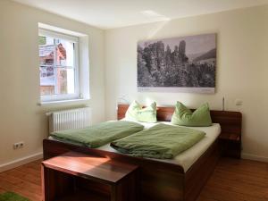 Ein Bett oder Betten in einem Zimmer der Unterkunft Apartment Felswelten