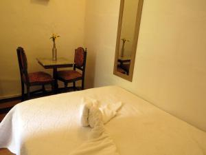 A bed or beds in a room at La Ventana Hostel & Bistrô