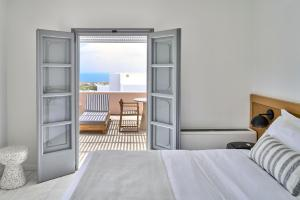 A bed or beds in a room at Vedema, a Luxury Collection Resort, Santorini