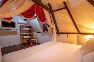 Cama ou camas em um quarto em Pousada Estalagem de Brotas