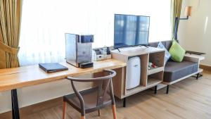 A kitchen or kitchenette at Sea Passion Hotel
