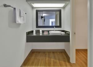 A bathroom at Super 8 by Wyndham Fort Smith
