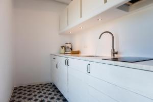 Cucina o angolo cottura di Milia Gi Suites