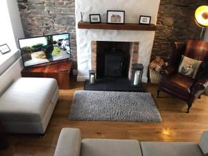 A seating area at Arthur Street Guest Cottage No16