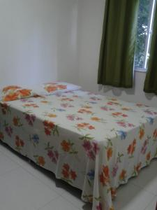 A bed or beds in a room at Doce Lar Ilhéus - Vog