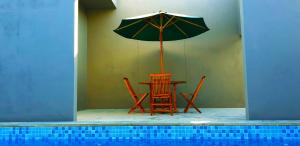 The swimming pool at or close to The Tanjung Seminyak Suites