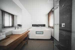 A bathroom at The Wing Boutique Hotel