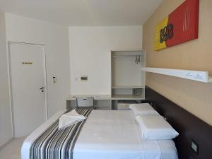 Cama ou camas em um quarto em Pousada Aquarela Do Brasil