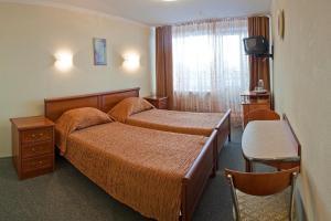 """Кровать или кровати в номере Гостиница """"Надежда"""""""