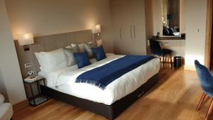 A bed or beds in a room at Tower Suites by Blue Orchid