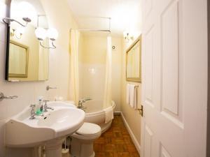 A bathroom at Wincham Hall Hotel