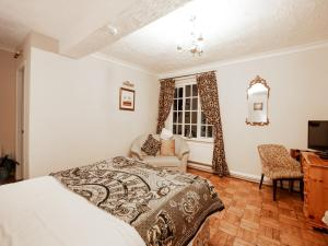 A bed or beds in a room at Wincham Hall Hotel