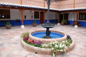The swimming pool at or near Hotel El Cortijo de Daimiel