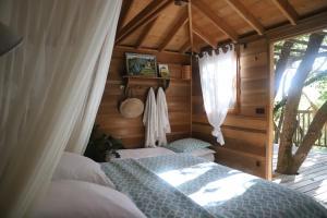 Un ou plusieurs lits dans un hébergement de l'établissement Orion Treehouses