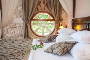 A bed or beds in a room at Heritage Boutique Hotel Adriatic-Adults only