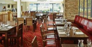A restaurant or other place to eat at Meon Valley Hotel, Golf & Country Club