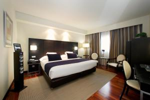 A bed or beds in a room at Attica21 Coruña