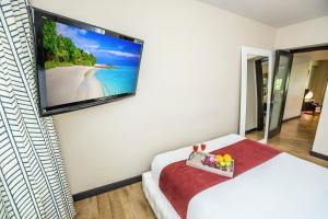 A television and/or entertainment center at Metropole Suites South Beach