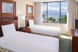 A bed or beds in a room at Aston Kaanapali Shores