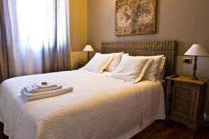 Letto o letti in una camera di Borgo Manzoni - Charming House