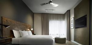 Cama o camas de una habitación en E&O Residences Kuala Lumpur