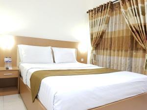 Ein Bett oder Betten in einem Zimmer der Unterkunft Morse Guesthouse Syariah