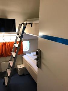 A bunk bed or bunk beds in a room at STF Jumbo Stay Stockholm