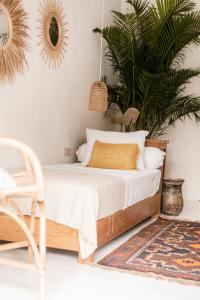 A bed or beds in a room at Dreamsea Canggu
