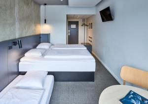 En eller flere senge i et værelse på Zleep Hotel Aarhus Viby