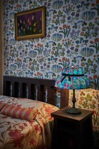 Кровать или кровати в номере Шале-Отель Таежные Дачи