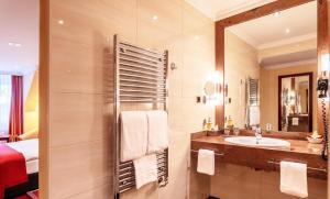 A bathroom at Amaris Hotel