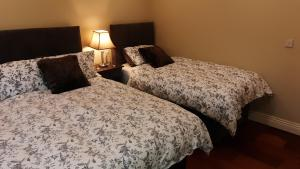 A bed or beds in a room at Safe Haven B&B
