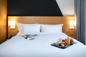 A bed or beds in a room at ONOMO Hotel Casablanca City Center