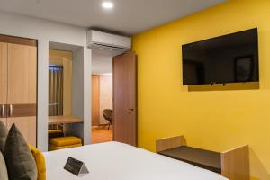 A television and/or entertainment center at Hotel Casino Internacional by Sercotel