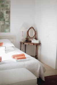 A bed or beds in a room at Casa la Concha Boutique Hotel