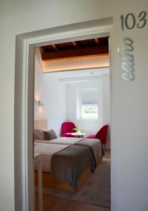 A bed or beds in a room at Hotel Nande