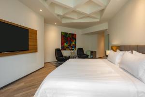 Hotel Portón Medellínにあるベッド