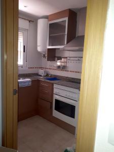 A kitchen or kitchenette at Apartment Av. Central - 2