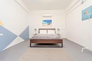 A bed or beds in a room at Guava House
