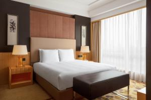 A bed or beds in a room at Courtyard by Marriott Shanghai Central