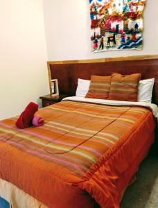 A bed or beds in a room at Antarctica Hostel