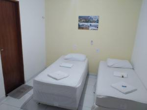 A bed or beds in a room at Pousada Trairi