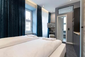 A bed or beds in a room at Aparthotel by dP