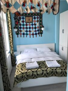 A bed or beds in a room at Tulip Guesthouse