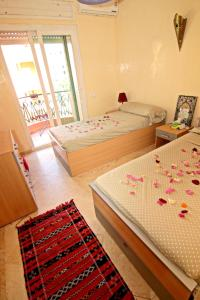 A bed or beds in a room at Apartment with 2 bedrooms in Marrakesh, with wonderful city view, furnished balcony and WiFi